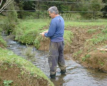 Stephan creating a chain barrier as a flood-gate in a river crossing