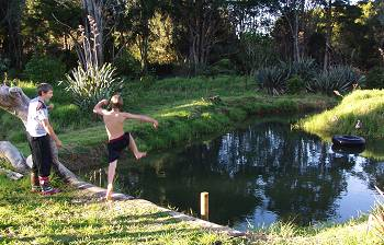 Patrick leaping into the pond
