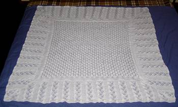 hand-knitted baby shawl